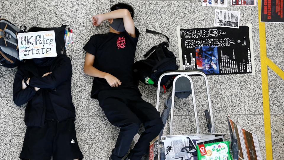 Protesters sleep on the floor during a demonstration at Hong Kong Airport. The 10 weeks of unrest, which has seen millions of people take to Hong Kong's streets, has become the biggest challenge to Chinese rule of the semi-autonomous city since its 1997 handover from Britain. The protests began in opposition to a bill that would have allowed extraditions to the mainland, but quickly evolved into a broader bid to reverse a slide of rights and freedoms in the southern Chinese city. (Thomas Peter / REUTERS)