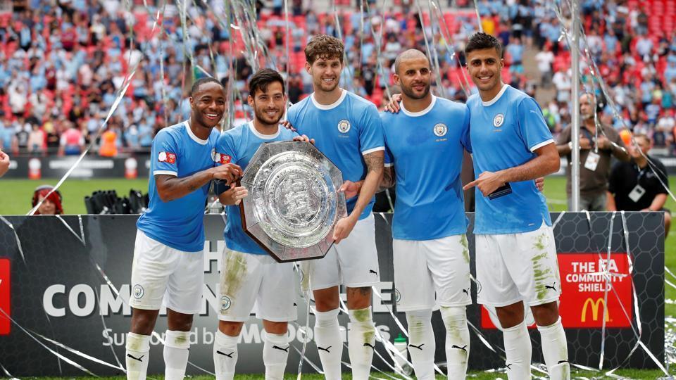 Manchester City's Raheem Sterling, David Silva, John Stones, Kyle Walker and Rodri pose as they celebrate winning the FA Community Shield.
