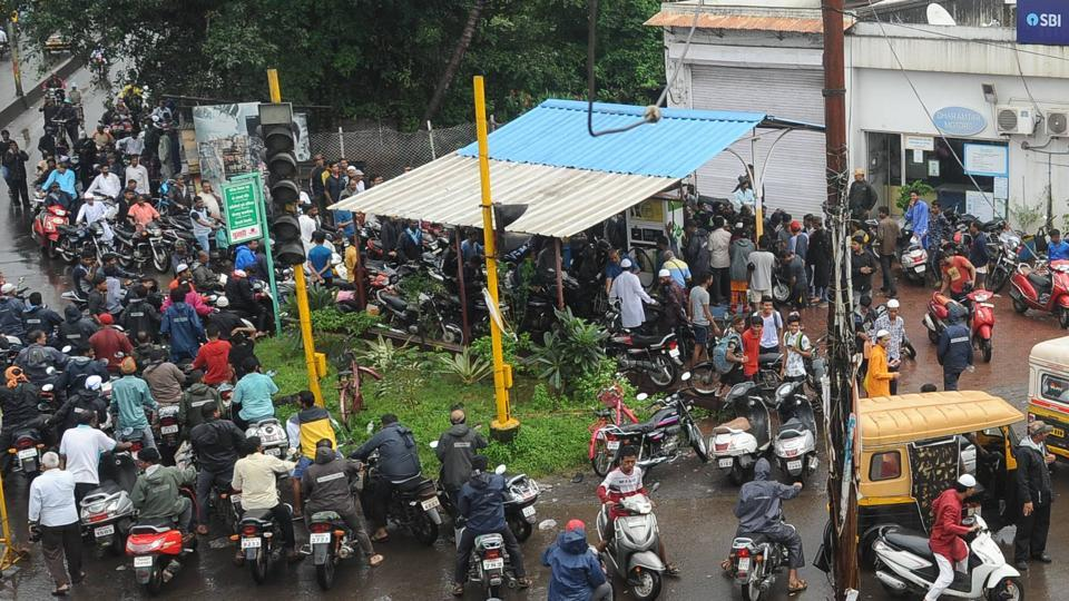People queue for fuel at a petrol pump near Uma talkies in Kolhapur on Monday.