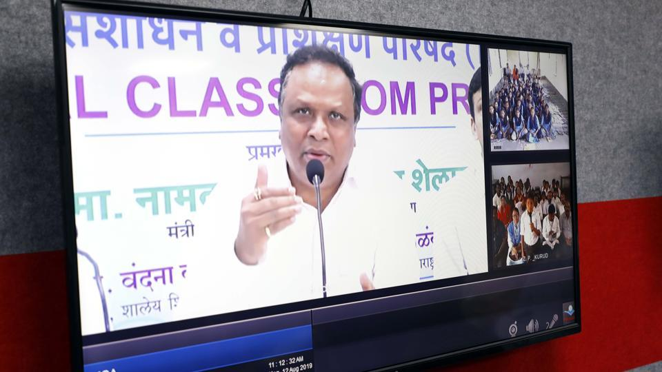Ashish Shelar, state minister for school education, interacts with students during a 'live' conference at the launch .