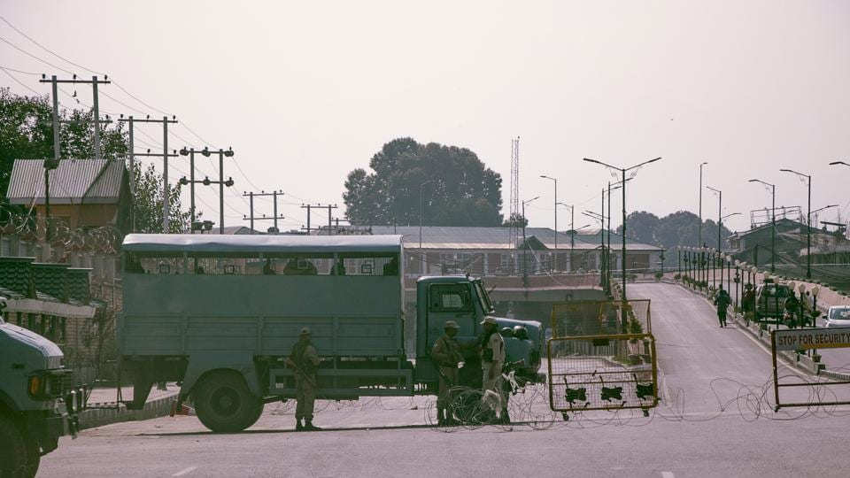 In this picture taken on August 12, 2019, security personnel patrol a street during a lockdown in Srinagar.