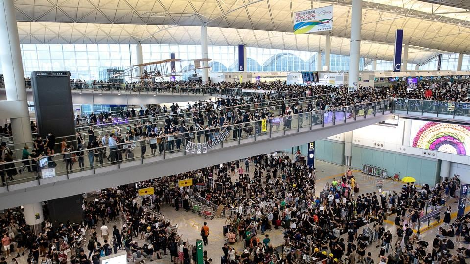 Demonstrators gather during a protest at the Hong Kong International Airport in Hong Kong, China, on Monday, August 12.