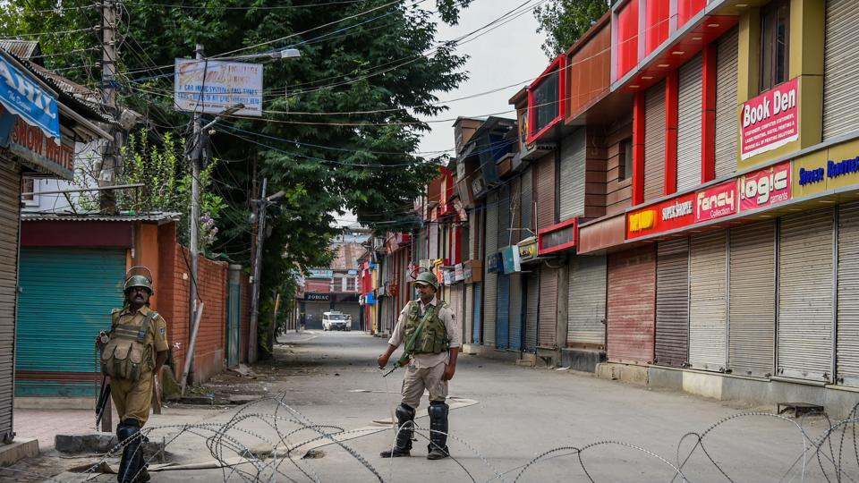 Security personnel stand guard during restrictions, in Srinagar on Monday.