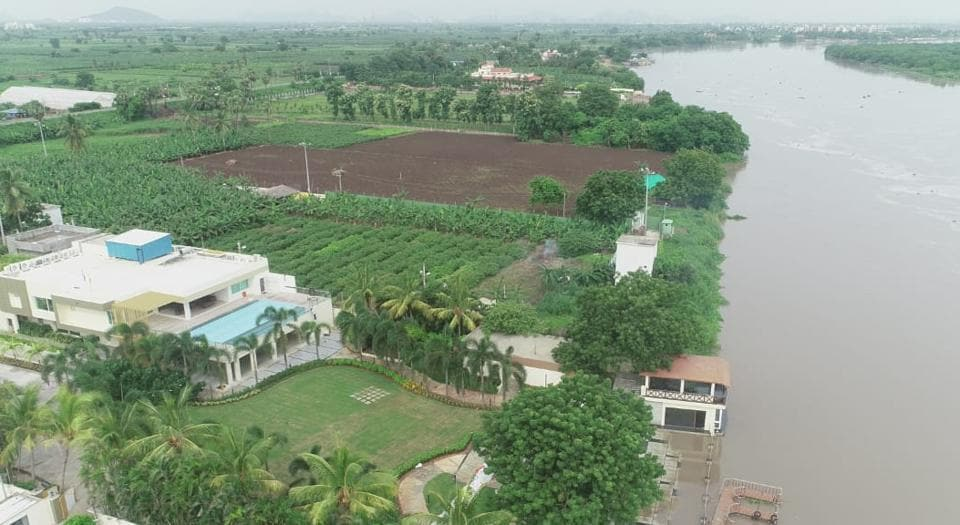 Telugu Desam Party president and former Andhra Pradesh chief minister N Chandrababu Naidu's residence at Amravati is facing the threat of flooding as a a bloated Krishna river continues to rise.