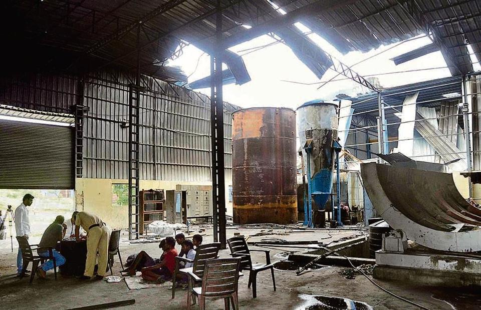Police survey the site where the boiler blast took place at CPH Manufacturing, an industrial unit in Velugaon, on Pune-Satara road on Wednesday.