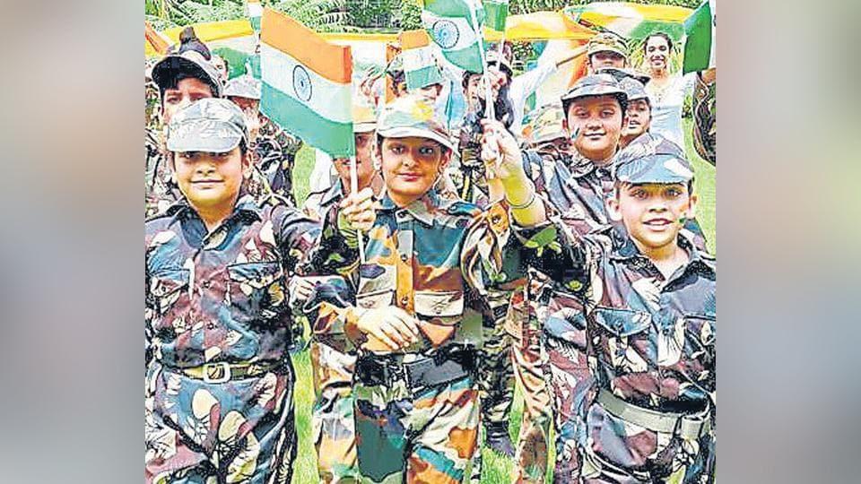 A parade of flag bearing students.