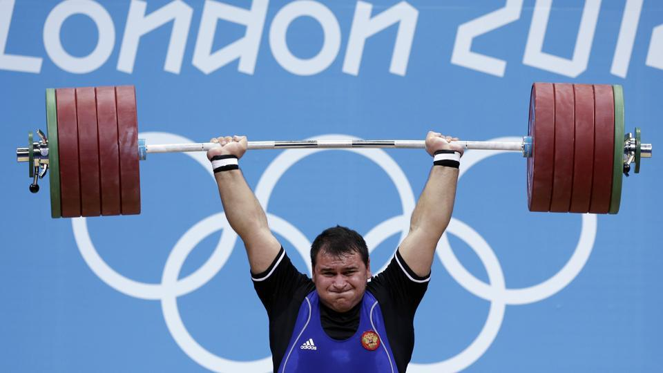 File image - In this file photo dated Tuesday, Aug. 7, 2012, Ruslan Albegov of Russia competes during men's over 105-kg weightlifting competition.
