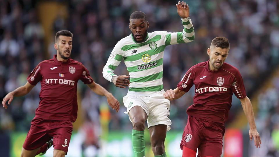 Celtic's Olivier Ntcham centre, battles for the ball with Cluj's Luis Aurelio, left and Mateo Susic.