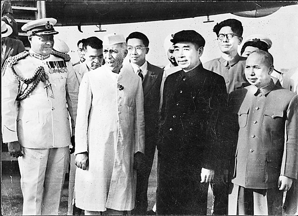 In the run up to signing the Panchsheel agreement: Jawaharlal Nehru with Zhou Enlai, the first Premier of the People's Republic of China (both centre) at Palam Airport on 25 June, 1954.