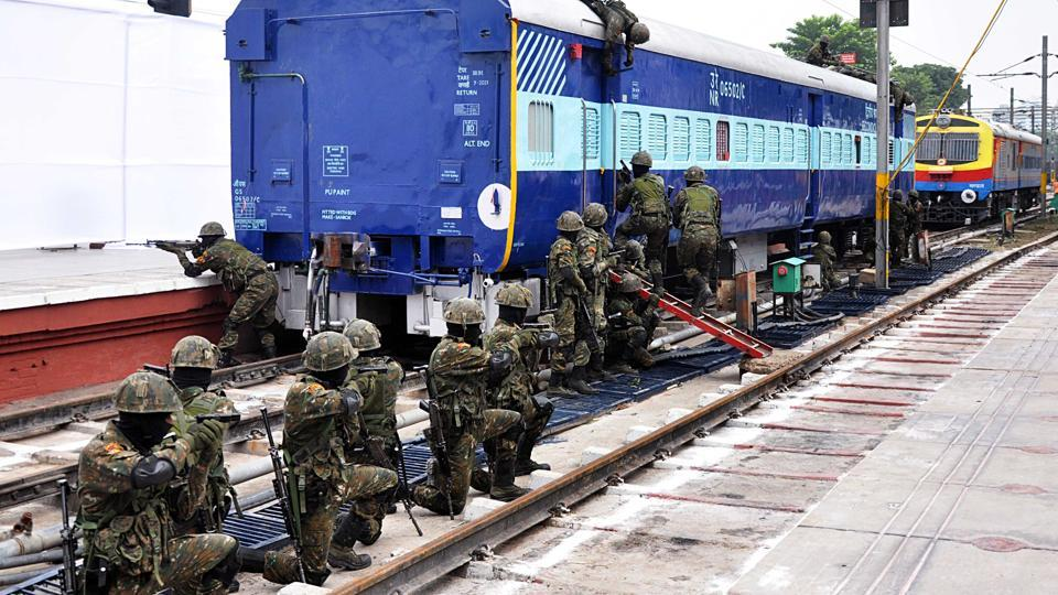 Commandos for Railway Security  (CORAS )  demonstrate their skills  during their launch at New Delhi station on Wednesday.
