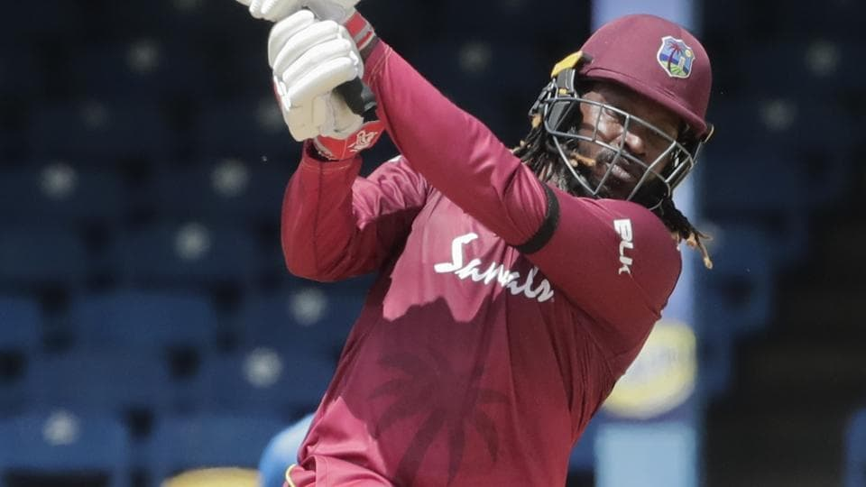 West Indies opening batsman Chris Gayle hits a four.