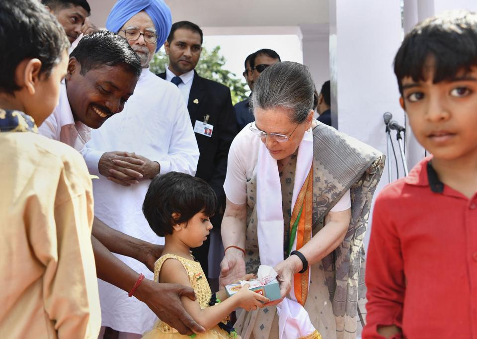 Congress party's interim president Sonia Gandhi offers sweets to a girl during 73rd Independence Day celebrations at AICC office, in New Delhi, Thursday, Aug 15, 2019.