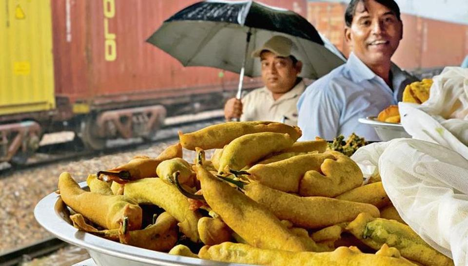 The stall selling green chilli pakoras is parked on platform 1 of Gurugram railway station, close to the main entrance.
