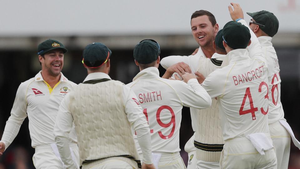 Australia's Josh Hazlewood celebrates with team mates after taking the wicket of England's Jason Roy.