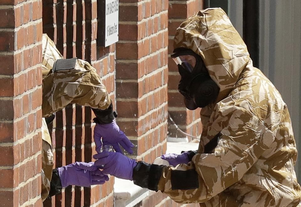 In this file photo specialist team members in military protective suits during Novichok nerve agent clean-up operations in Salisbury, England. British police confirmed Thursday Aug. 15, 2019, that a second police officer who responded to the March 2018 nerve agent attack in the English city of Salisbury was exposed to the agent Novichock, after tests confirmed the exposure.