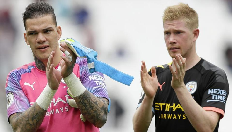 Manchester City's goalkeeper Ederson and Kevin De Bruyne, right, applaud at the end.