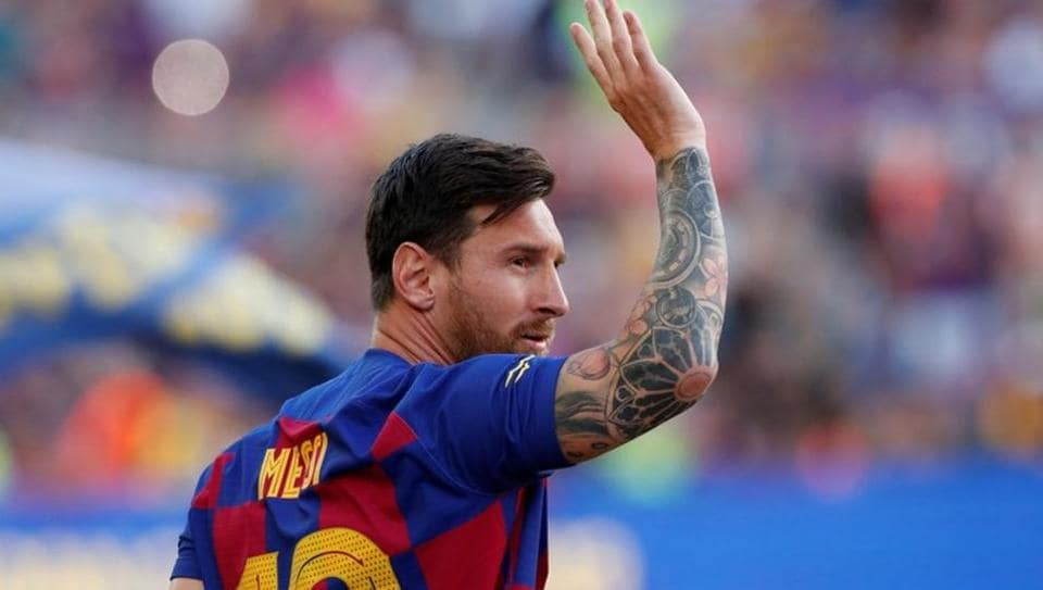 Barcelona's Lionel Messi waves to fans before the match.