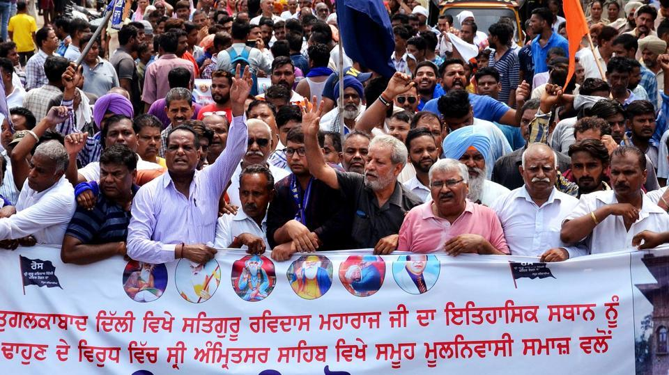 Members of Guru Ravidas Sabha Punjab during a protest march over the demolition of Guru Ravidas temple in Delhi, during Punjab Band Call in Amritsar on Tuesday, August 13, 2019.