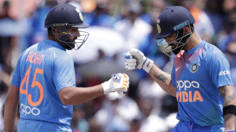 India's Rohit Sharma, left, bumps fist with Virat Kohli.