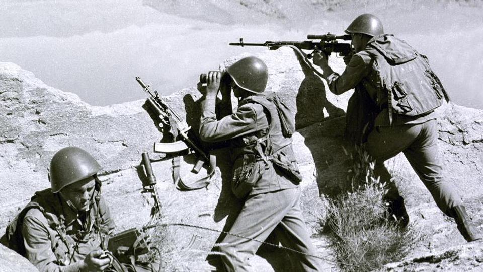 In this late April 1988, file photo, Soviet soldiers observe the highlands, while fighting Islamic guerrillas at an undisclosed location in Afghanistan.
