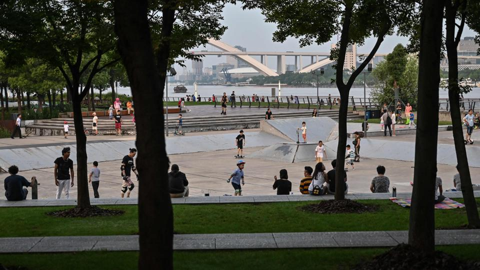People skateboarding at a park near the Shanghai Long Museum in Shanghai. There is a sign saying the area is for skateboarding only, but it is so small that few people see it and security guards show little desire to enforce the rule. The facility is also falling into disrepair, the concrete cracked and crumbling, while metal grooves running along the ground are an unwelcome hazard.  (HECTOR RETAMAL / AFP)