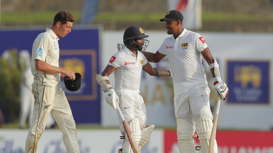 Sri Lankan batsmen Niroshan Dickwella, center, and Suranga Lakmal cheer each others.