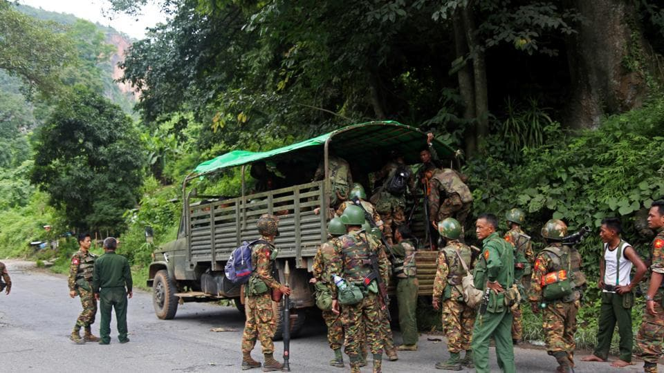 Myanmar army soldiers queue to climb into a vehicle after an insurgent attack on the Myanmar-China major trading route in Nawnghkio township, Shan state, Myanmar August 15, 2019.