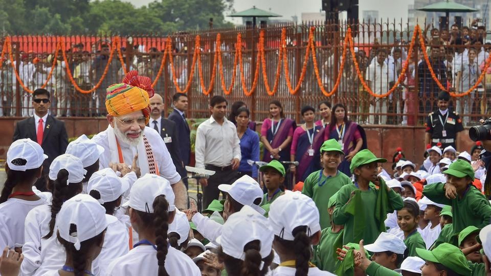Prime Minister Narendra Modi meets school children after addressing the nation from the ramparts of the historic Red Fort on the occasion of 73rd Independence Day, in New Delhi, Thursday, Aug 15, 2019.