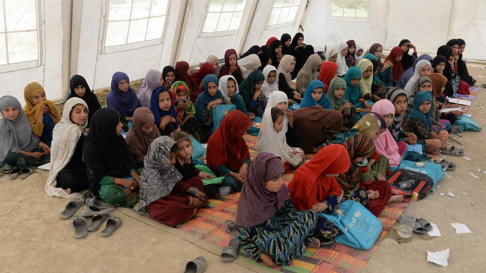 In this photo taken on July 22, 2019, Afghan schoolchildren study at the destroyed Papen High School in Deh Bala district of Nangarhar province.