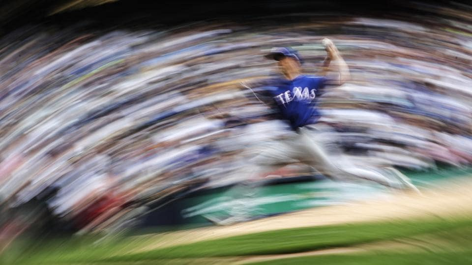 Texas Rangers starting pitcher Mike Minor throws during the seventh inning of a baseball game against the Milwaukee Brewers on August 11, 2019, in Milwaukee. (Morry Gash / AP)