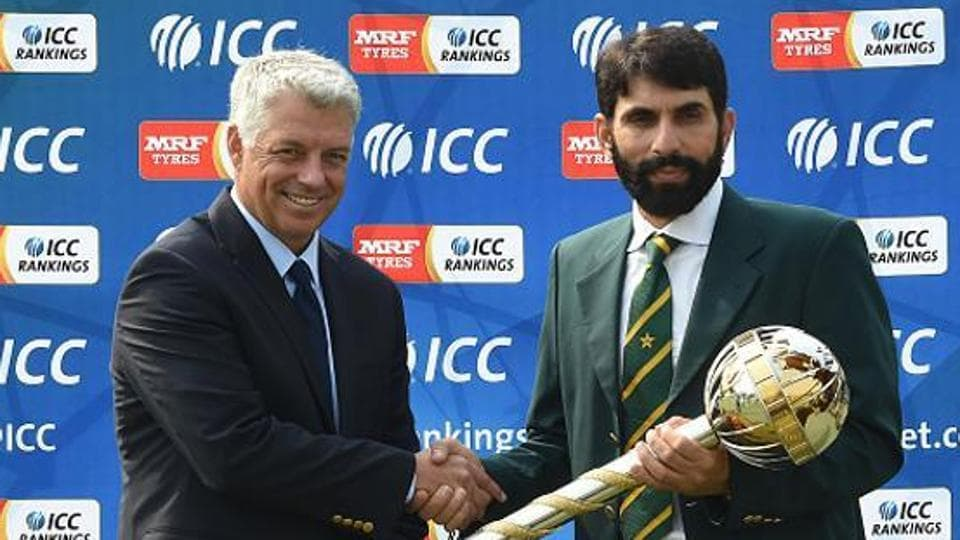 Former Pakistan cricket captain Misbah-ul-Haq (R) with ICC Chief Executive David Richardson.