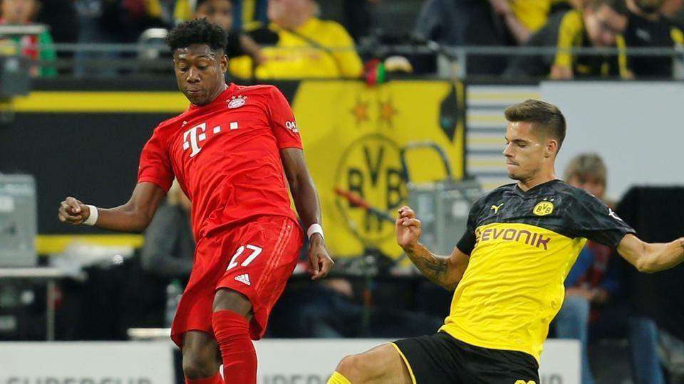 Bayern Munich's David Alaba in action with Borussia Dortmund's Julian Weigl.