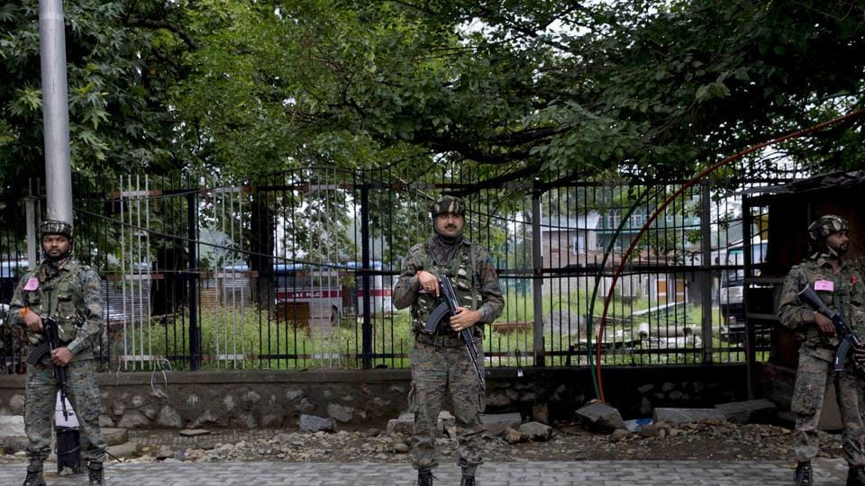 Paramilitary soldiers stand guard in Srinagar on Thursday, Aug. 15, 2019.