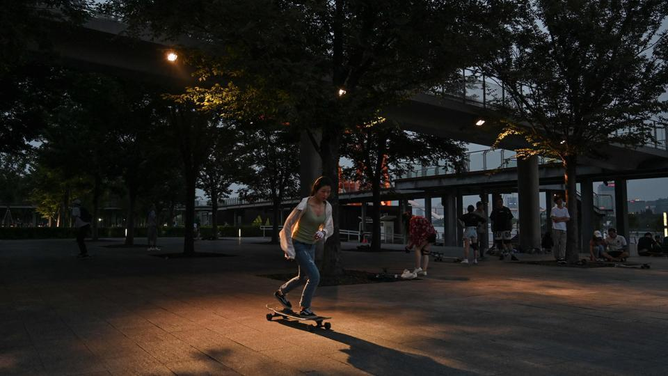 "The skateboarders would be happy to practise on the streets or in other public spaces, but sometimes they are fined or chased away by the black-shirted security guards that are omnipresent in Chinese cities. ""To clear us out of here, security guards even sprayed water on the ground before. From Monday to Friday, they will not care too much about you, but on weekends they are strict and drive us away,"" said Chen, a university student. (HECTOR RETAMAL / AFP)"