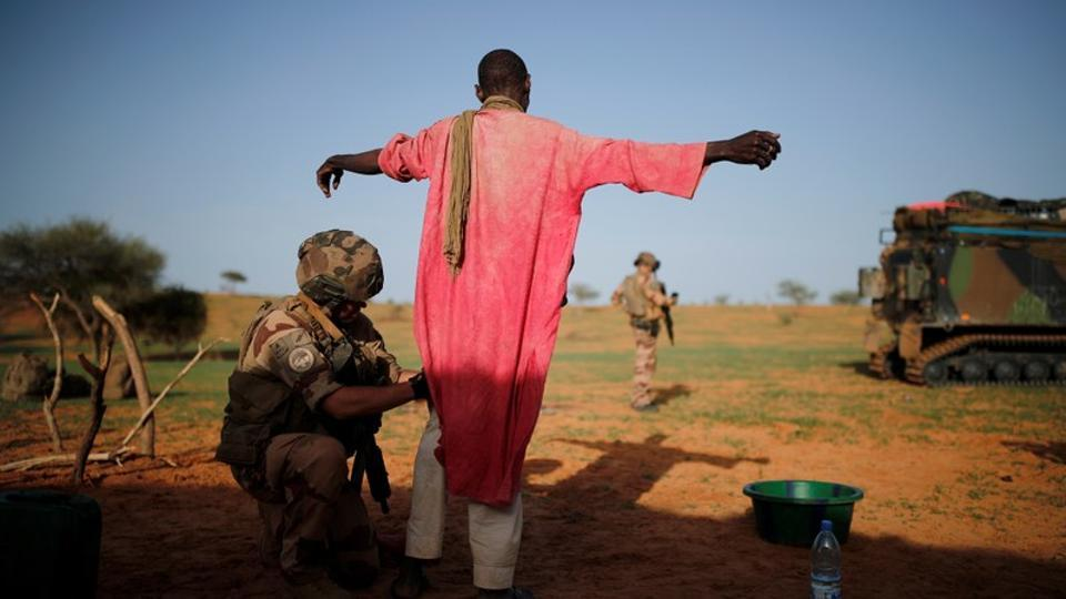 A French soldier of the 2nd Foreign Engineer Regiment searches a man during Operation Barkhane in Ndaki, Mali. The 4,500 French troops deployed in this patchwork of former French colonies for 'Operation Barkhane' face huge logistical challenges in hostile terrain. Hardest of all, they rely on the cooperation of a civilian population spread thinly across vast and remote spaces, often either sympathetic to the Islamists or terrified of informing on them. (Benoit Tessier / REUTERS)