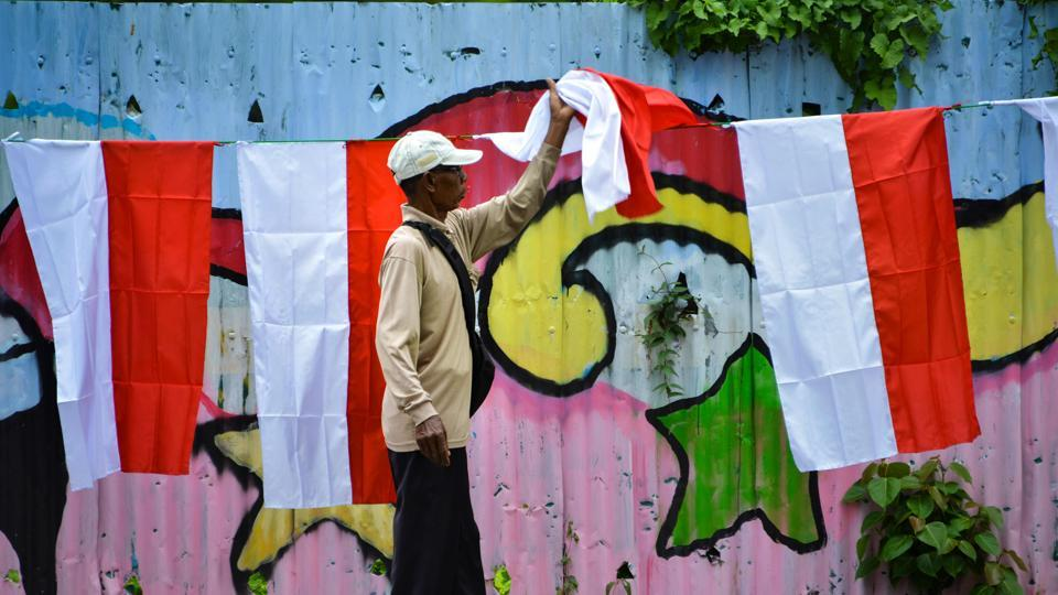 A man sells Indonesian national flags on a street ahead of the Indonesia Independence Day in Banda Aceh. Indonesia marks its Independence Day on August 17.  (CHAIDEER MAHYUDDIN / AFP)