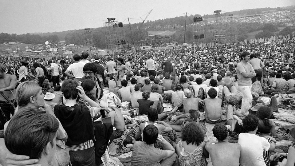 FILE - This Aug. 14, 1969 file photo shows a portion of the 400,000 concert goers who attended the Woodstock Music and Arts Festival held on a 600-acre pasture near Bethel, N.Y. For the first time, an audio recording is available of nearly everything heard onstage at Woodstock 50 years ago -  A 38-disc package