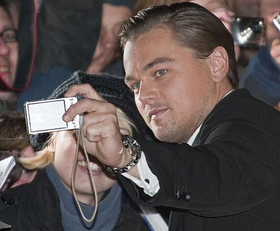 Leonardo Di Caprio takes a selfie with a fan at the Berlin Film Festival in 2010.