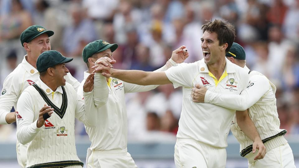 London: Australia's Pat Cummins, right celebrates with teammates after taking the wicket of England's Joe Root caught behind during play on day four of the 2nd Ashes Test cricket match between England and Australia at Lord's cricket ground in London, Saturday, Aug. 17, 2019.