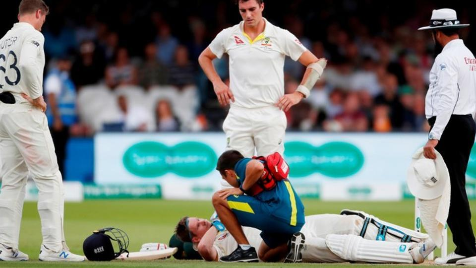 Australia's Steve Smith receives treatment as he lays on the floor after being hit by a ball from England's Jofra Archer as England's Jos Buttler and Australia's Pat Cummins look on