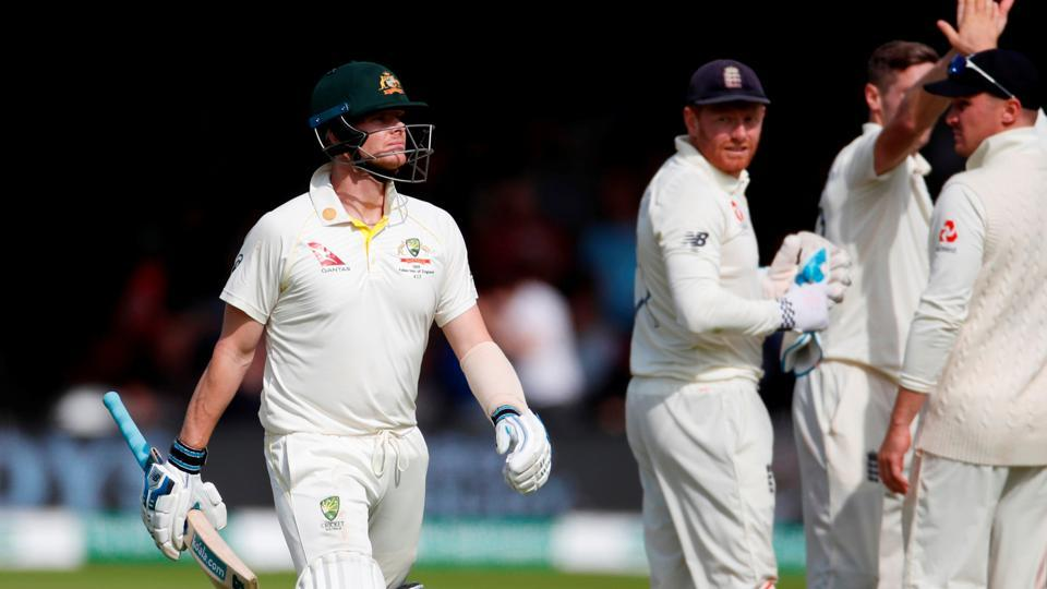 Australia's Steve Smith walks after losing his wicket.