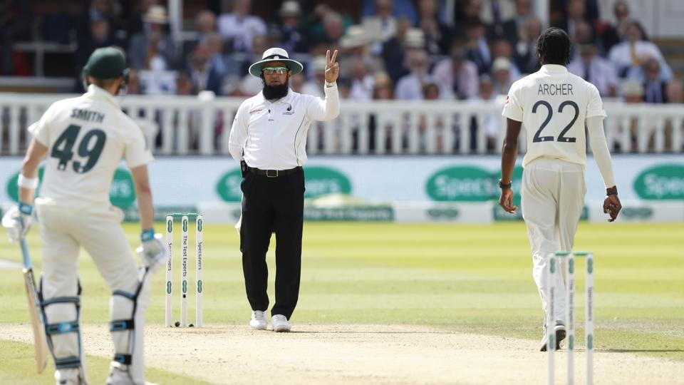 Umpire Aleem Dar warns England's bowler Jofra Archer that he has bowled two delivers above head height during play
