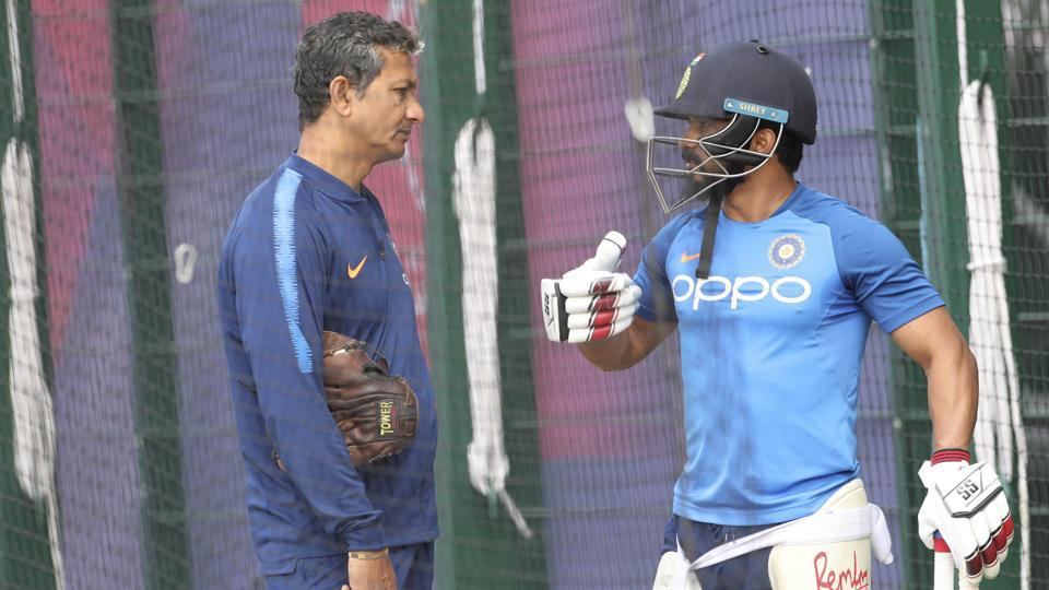 India's Kedar Jadhav, right, talks to batting coach Sanjay Bangar.