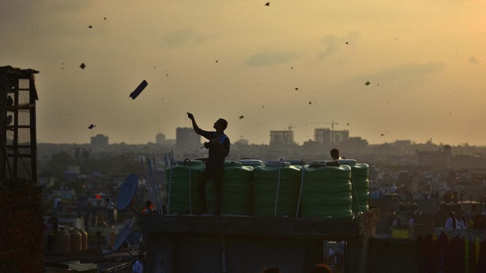 A man is silhouetted as people fly kites on the rooftop of their houses to celebrate India's 73rd Independence Day in the old quarters of the city, in New Delhi. (Raj K Raj / HT Photo)