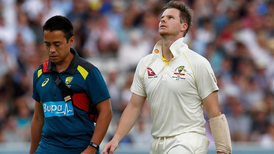 Australia's Steve Smith (R) walks off of the pitch after being hit in the head by a ball off England's Jofra Archer.