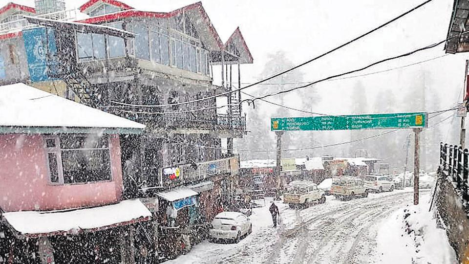 Snow-covered road seen after fresh snowfall in Shimla district of Himachal Pradesh in March 14, 2019.  Hundreds of tourists were left stranded near a lake in Lahaul and Spiti district.