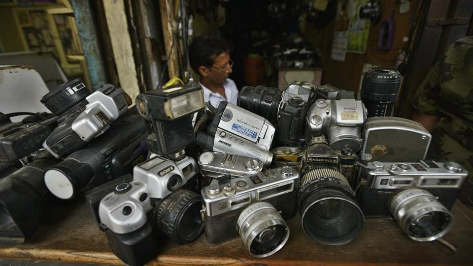 NK Giri, 39, from Bulandshahr in Uttar Pradesh has owned a shop in Delhi's Kutcha Choudhary Market, for 20 years now. He uses functioning parts from old cameras to repair newer ones. Giri refers to his process as 'jugaad'. His work is now a mainstay for many in a market flourishing since the days of film photography and now placed in a landscape that has shifted to the digital medium. (Raj K Raj / HT Photo)