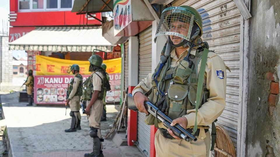 Security personnel stand guard at a check point during restrictions in Srinagar, Sunday, Aug 18, 2019.