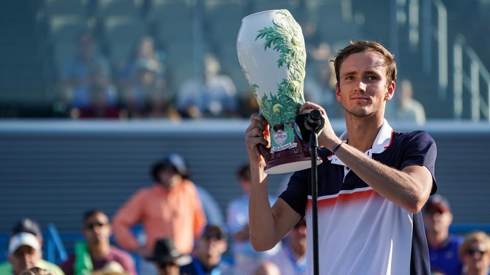 Daniil Medvedev poses for a photo with the Rookwood Cup after defeating David Goffin in the final of the Cincinnati Masters. s