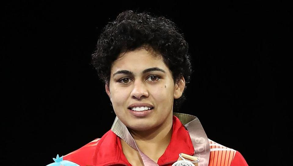 Pooja Dhanda during the medal ceremony for the Women's Freestyle 57 kg at Gold Coast 2018 Commonwealth Games.